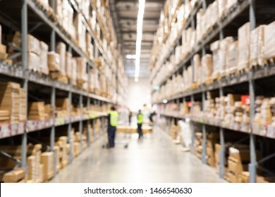 blurred worker check stock at warehouse storage factory for logistic transportation . many brown goods packaging on shelf in storehouse .