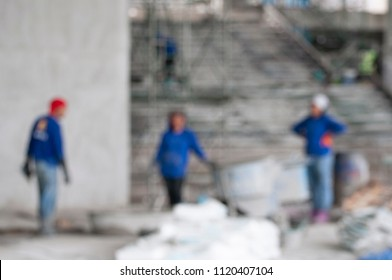 Blurred  worker pouring concrete at construction site. Blurred construction worker in construction site . Safety construction concept .