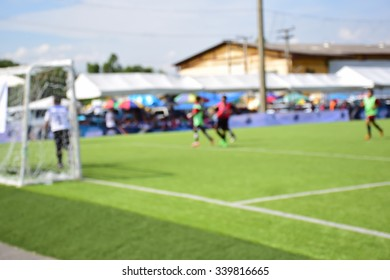 Blurred of young kids playing a youth soccer match outdoors