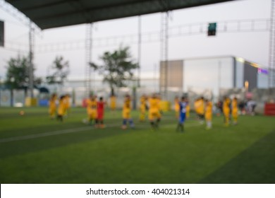 Blurred of young kids playing a youth soccer match