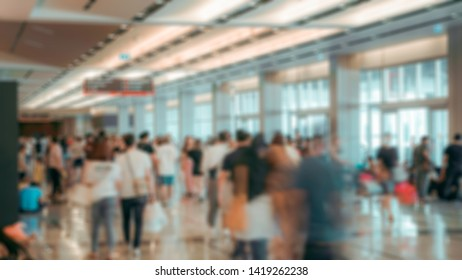 Blurred,defocused background of Crowd in trade event exhibition hall. Business tradeshow,shopping mall and marketing advertisement concept,MICE industry business concept