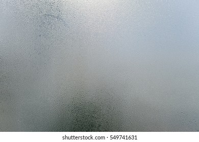 Blurry abstract background of foggy condensation on window glass natural surface