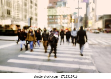 Blurry abstract background image of people walking on busy street