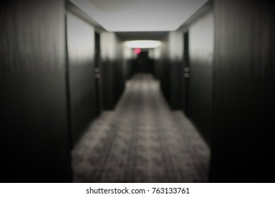 Blurry Abstract Hallway in a Hotel with a red light at the end of the hallway