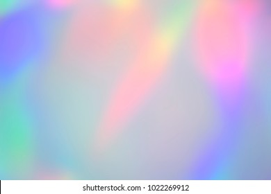 Blurry abstract iridescent holographic foil background
