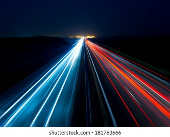 Blurry abstract photo of the lights of cars on the highway