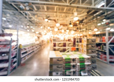 Blurry abstract wide selection of ceiling fans with lights on display at home improvement store in America. Defocused background variety of coastal, classic, modern, cottage, rustic, industrial, LED