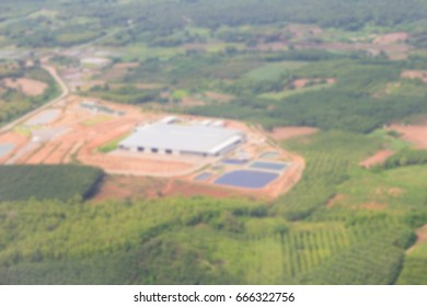 Blurry Aerial view on the construction site of the new factory