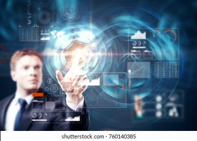 Blurry attractive young man using abstract digital business interface. Infograph and future concept. Double exposure