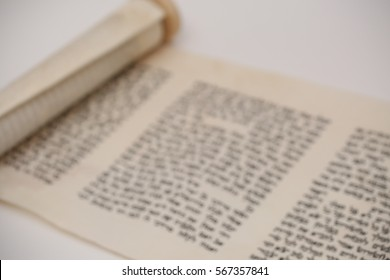 Blurry background of the Book of Esther on a white background. Subject image of the Jewish Purim holiday, with space for text