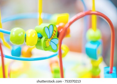 Blurry background of colorful Baby toys, Baby's learning equipment for learning skill. Selective focus on some piece of toy.
