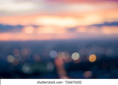Blurry Background and copy space of cityscape concept with cloud and sky at the twilight time or sunset time with soft focus and pastel tone