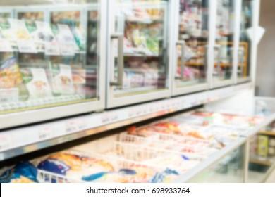 Blurry Background of Frozen food department in supermarket.