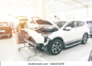 Blurry background Full body of car repair in the station of garage shop with soft light. Car maintanance.