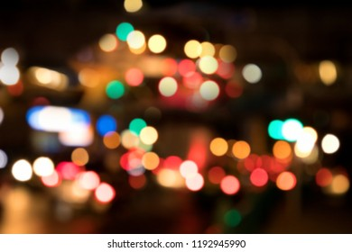 Blurry background image of defocused colorful abstract city street lights at night