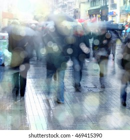 blurry background image of people walking on busy street