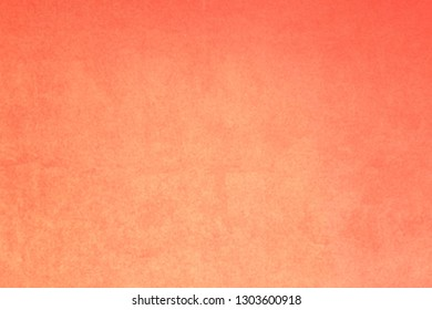 Blurry background of pastel orange cement wall.