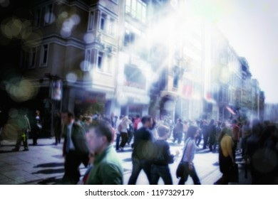 Blurry background of people walking on busy city street
