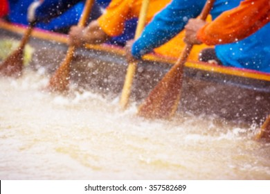 blurry background of rowing team race