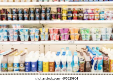 Blurry Background of Shelves of Milk and yogurt in a supermarket.