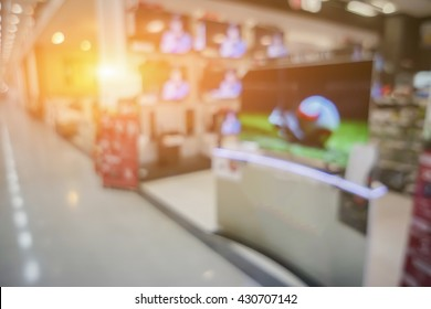 blurry background of a shop selling household appliances and TVs was blurred for use as a background,vintage color