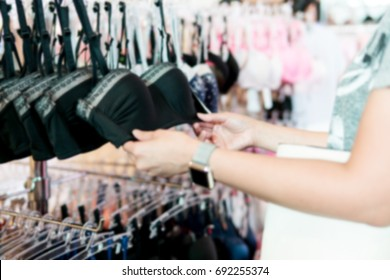 Blurry Background of Teen girl choose a bra in black. Specifically choose a bra with a lot of foam. To make small breasts look bigger to strengthen self-confidence.