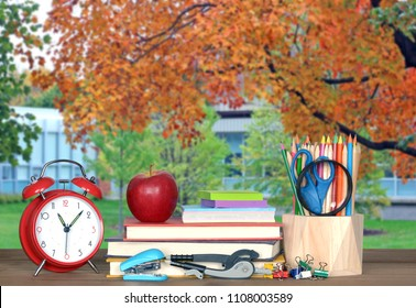 blurry background of university campus in Fall season and book for education and back to school concept