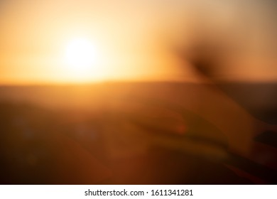 Blurry background with warm sunset or sunrise, defocused