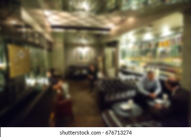 blurry background of whisky bar and restaurant with vintage tone.