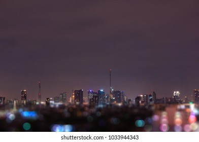Blurry Bangkok night view with skyscraper in business district in Bangkok Thailan