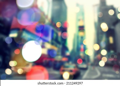 Blurry bokeh background of vintageTimes Square in New York
