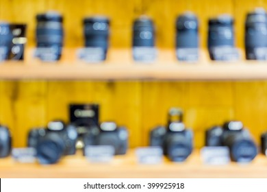 Blurry cameras and lenses in camera store shelf. Great image for your background