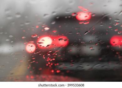 Blurry Car Tail Lights Through Windshield with Rain