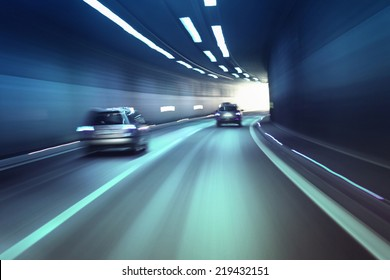 Blurry chromatic color tunnel car traffic motion blur.