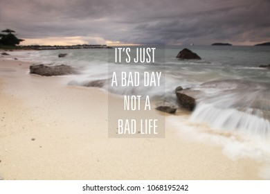 Blurry cloudy sky with Inspirational quote - It's just a bad day not a bad life
