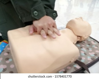 Blurry of CPR Training Chest Compression on Manikin. hand student Heart pump with medical dummy on CPR, in emergency refresher training to assist of physician.