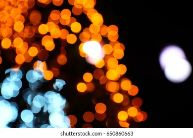 Blurry focus of colorful lighting boheh in the night. Party nightlife cerebration.