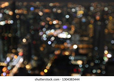 Blurry focus on night light, bokeh at night in abstract background concept.