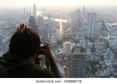 Blurry focus of peoples on camera at the landscape view.