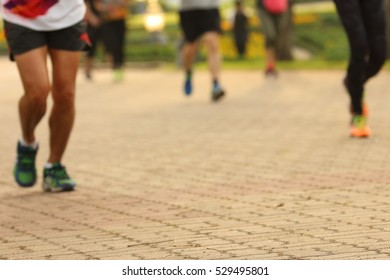 Blurry focus workout subject in park,health care concept