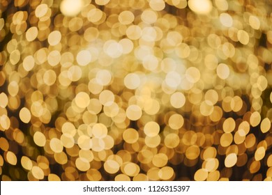 Blurry garland with little lights. Orange toning. Christmas coming concept.