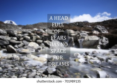 Blurry himalayan river with Inspirational quote - A head full of fears has no space for dreams