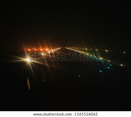 Blurry illuminated airport runway lights at night unique photograph