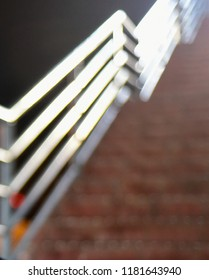 Blurry illuminated metallic protection grill of a stairs isolated unique photo