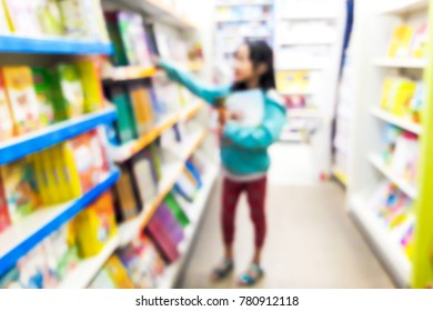 Blurry image of children reading books in bookstores.