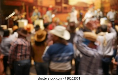 Blurry image in cowboy night party concert.