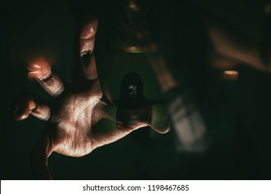 blurry image and double exposure ghost woman hand in haunted hotel with dark filter, halloween concept