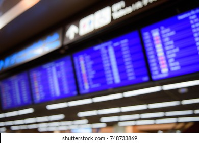 Blurry image of flight schedule board
