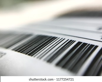 blurry image of modern tag barcode technology on paper letter to scan by personal mobile phone, easy simple method to pay or transfer by digital money, marketing internet or financial business concept