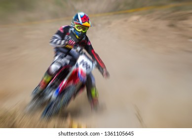 Blurry image of motorcycle rider during motocross race